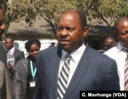 Obediah Moyo Zimbabwe's minister of health says there is no going back on vendors in streets, in Harare, Sept. 2018.
