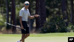 President Barack Obama reacts after putting on the first green as he plays golf at Farm Neck Golf Course in Oak Bluffs, Mass., on Martha's Vineyard, Aug. 7, 2016.