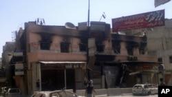 叙利亚政府军和反政府武装在首都大马士革南面进行战斗后的街头情况