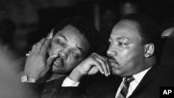 FILE -Dr. Martin Luther King, Jr. is seen here with Rev. Jesse Jackson (L) just prior to his final public appearance to address striking Memphis sanitation workers on April 4, 1968.