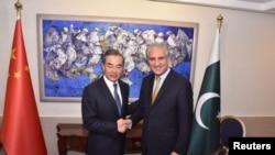 چین کے وزیر خارجہ وانگ ژی دورہ پاکستان کے دوران پاکستانی وزیر خارجہ شاہ محمود قریشی کے ساتھ۔ فائل فوٹو