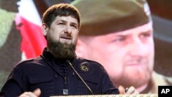 FILE - Chechen leader Ramzan Kadyrov speaks at a Defenders of the Fatherland Day celebration in the provincial capital of Grozny, Russia, Feb. 20, 2016. He's been nominated for another term, despite criminal allegations.