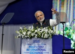 India's Prime Minister Narendra Modi delivers a speech after he inaugurated the country's first international exchange in Gandhinagar, India, Jan. 9, 2017.