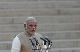 India's Prime Minister Narendra Modi takes his oath at the presidential palace in New Delhi May 26, 2014