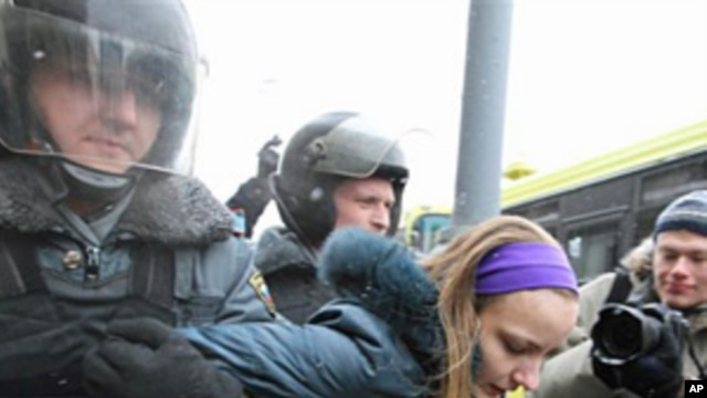Police detain a protester in Moscow, February 12, 2011
