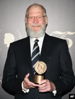 David Letterman accepting an award in May.