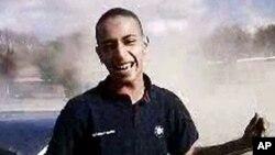 ຮູບພາບນາຍ Mohammed Merah, ໄວ 24 ປີ ຜູ້ຕ້ອງົສງໄສ ທີ່ສັງຫານຜູ້ຄົນໃນເມືອງ Toulose , ຝຣັ່ງ ທີ່ປາກົດໃຫ້ເຫັນ ໃນໂທລະພາບຝຣັ່ງ. ວັນທີ 22 ມີນາ 2012.