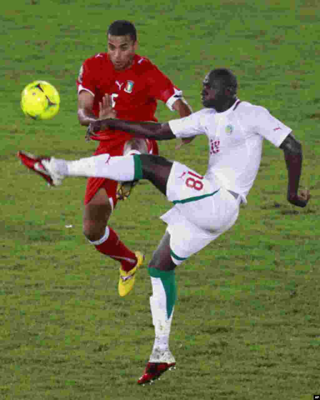 Edjogo of Equatorial Guinea challenges N'Daw of Senegal during their African Nations Cup Group A soccer match at Estadio de Bata