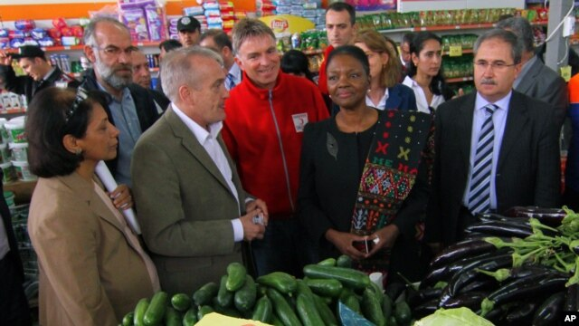 Valerie Amos, Under-Secretary-General and Emergency Relief Coordinator of the UN Office for the Coordination of Humanitarian Affairs, OCHA, second right, visiting a Syrian refugee camp near the Turkish-Syrian border, Turkey, March 13, 2013.