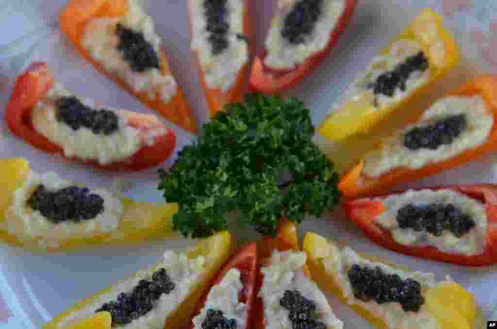 Caviar, coming from the unfertilized roe of sturgeon, are a delicacy. (VOA - S. Herman)