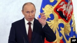 Russian President Vladimir Putin speaks during a state-of-the-nation address in Moscow, Russia, Dec. 12, 2012.