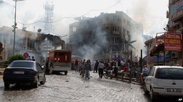 Firefighters work at one explosion site in Reyhanli, near Turkey's border with Syria, May 11, 2013.