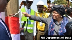 Liberia President Ellen Johnson Sirleaf flips the switch at the Mount Coffee Hydropower Plant.
