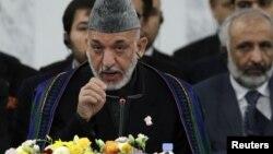 8일 일본 도쿄에서 열린 아프가니스탄 지원국 회의에서 발언하는 하미드 카르자이 아프간 대통령.