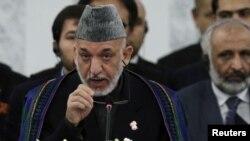 Presiden Afghanistan Hamid Karzai berpidato pada pembukaan konferensi untuk pembangunan kembali Afghanistan di Tokyo, Jepang (8/7).