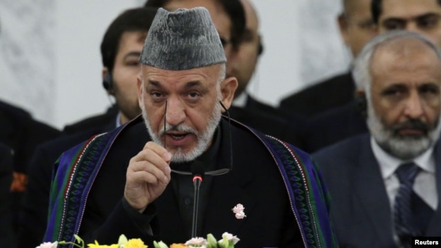 Afghan President Hamid Karzai speaks during an opening session at the Tokyo Conference on the Reconstruction of Afghanistan, in Tokyo, Japan, July 8, 2012.