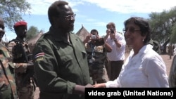 UN human rights chief Navi Pillay meets with South Sudanese opposition leader Riek Machar at an undisclosed location.