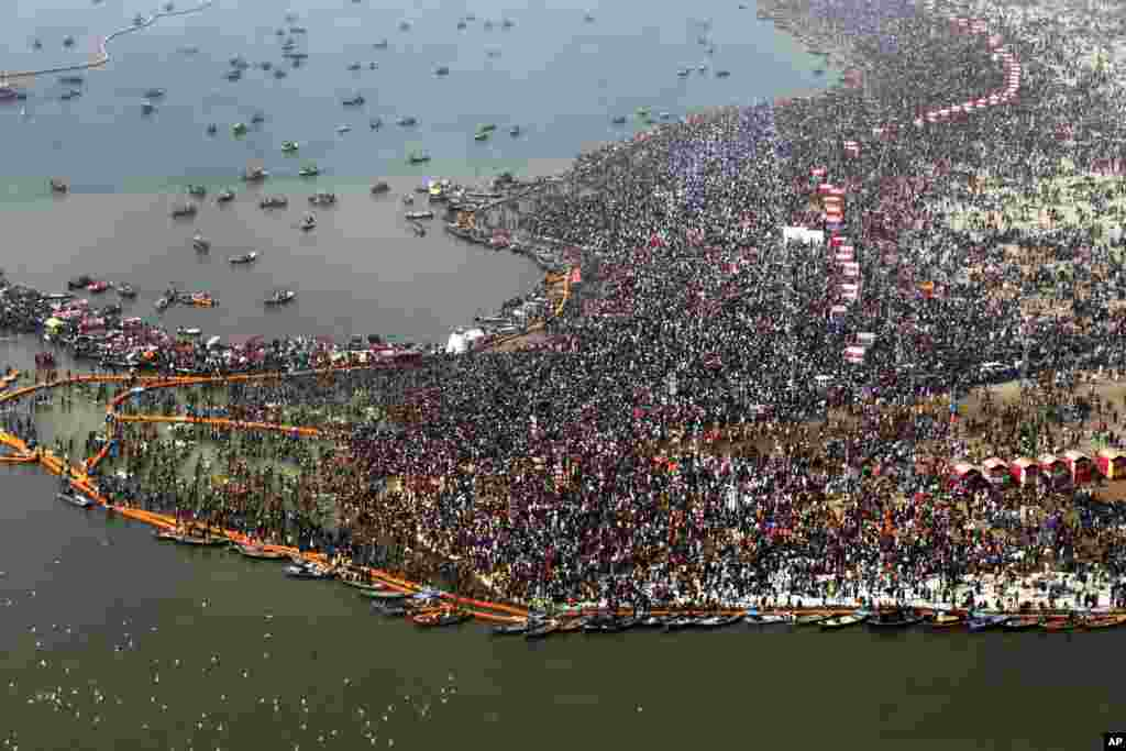 An aerial view of thousands of Hindu devotees taking dips at Sangam, the confluence of three sacred rivers the Yamuna, the Ganges and the mythical Saraswati, on Mauni Amavsya or the new moon day, the most auspicious day during the Kumbh Mela or the Pitcher Festival, in Prayagraj, Uttar Pradesh state, India, Feb. 4, 2019.