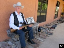 In this Tuesday, March 15, 2016 photo, Jim Chilton poses for a photo on the front porch of his home on his 50,000 acre ranch along the U.S-Mexico border in Arivaca, Arizona.