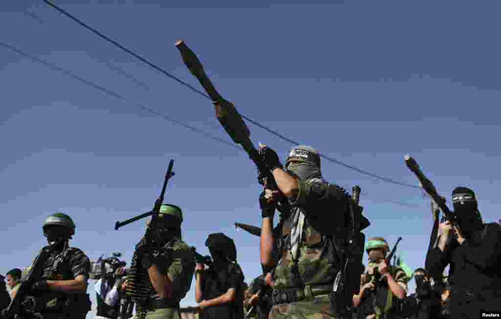 Palestinian members of the al-Qassam brigades, the armed wing of the Hamas movement, stand guard as they wait for the arrival of Hamas chief Khaled Meshaal in Rafah in the southern Gaza Strip, December 7, 2012.
