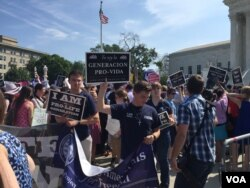 Pro-life demonstrators wave signs and make their voices heard after the Supreme Court upheld abortion rights in a 5-3 decision, in front of the Supreme Court building in Washington, June 27, 2016. (J. Oni / VOA News)