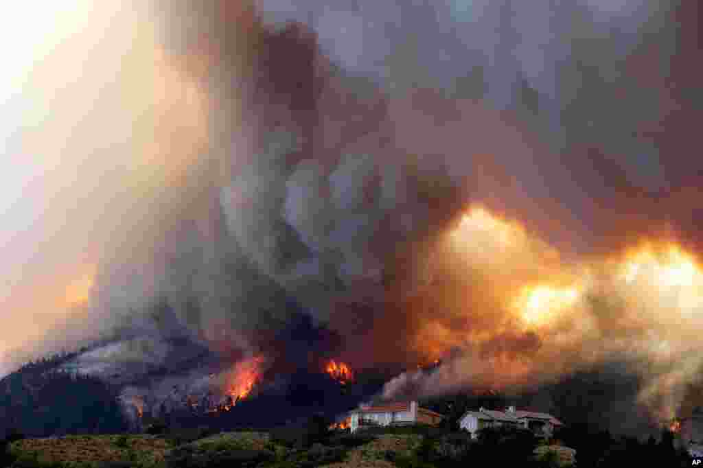 June 26: The Waldo Canyon wildfire burns as it moved into subdivisions and destroyed homes in Colorado Springs, Colorado.