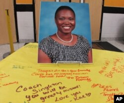FILE - A picture of Sharonda Coleman-Singleton sits on a large paper signed by students, teachers and friends in Goose Creek, South Carolina, June 18, 2015.