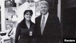 FILE - Official White House photo from the Independent Counsel Kenneth Starr's report on President Clinton, showing the president and Monica Lewinsky at the White House, Nov. 17, 1995.