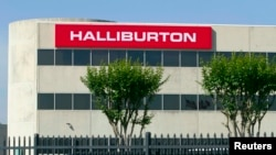 FILE - Corporate offices for Halliburton oilfield services are in Houston, Texas. The U.S. Justice Department is suing to prevent the firm from acquiring rival Baker Hughes Inc.