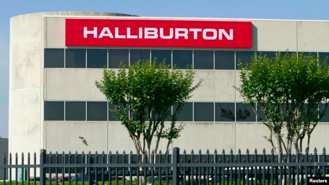FILE - The company logo of Halliburton oilfield services corporate offices is seen in Houston, Texas.