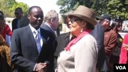 Kenyan Senator Lenny Kivuti chats with a Congresswoman at the Capitol in Washington DC.