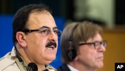 Chief of Staff of the Free Syrian Army Gen. Salim Idris addresses the media after he discussed the situation in Syria with the leader of the Group of the Alliance of Liberals and Democrats for Europe Guy Verhofstadt, right, at the European Parliament.