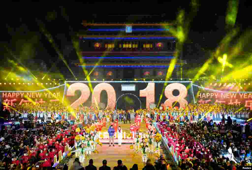 People celebrate the new year during a countdown event at Yongdingmen Gate in Beijing, China, Jan. 1, 2018.