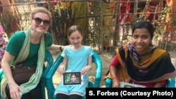 Sasha Forbes, left, and her 9-year-old daughter Maya, middle, meet their sponsored girl in Khulna, Bangladesh, April 2018.