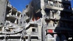 Fotografija agencije Tika na kojoj se vide bombardovane zgrade Al Šara u Alepu u Siriji, 18. novembar 2016.