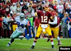 Dec 22, 2013; Landover, MD, USA; Washington Redskins quarterback Kirk Cousins (12) throws the ball as Dallas Cowboys defensive end DeMarcus Ware (94) rushes during the first half at FedEx Field. Mandatory Credit: Brad Mills-USA TODAY Sports - RTX16RRW