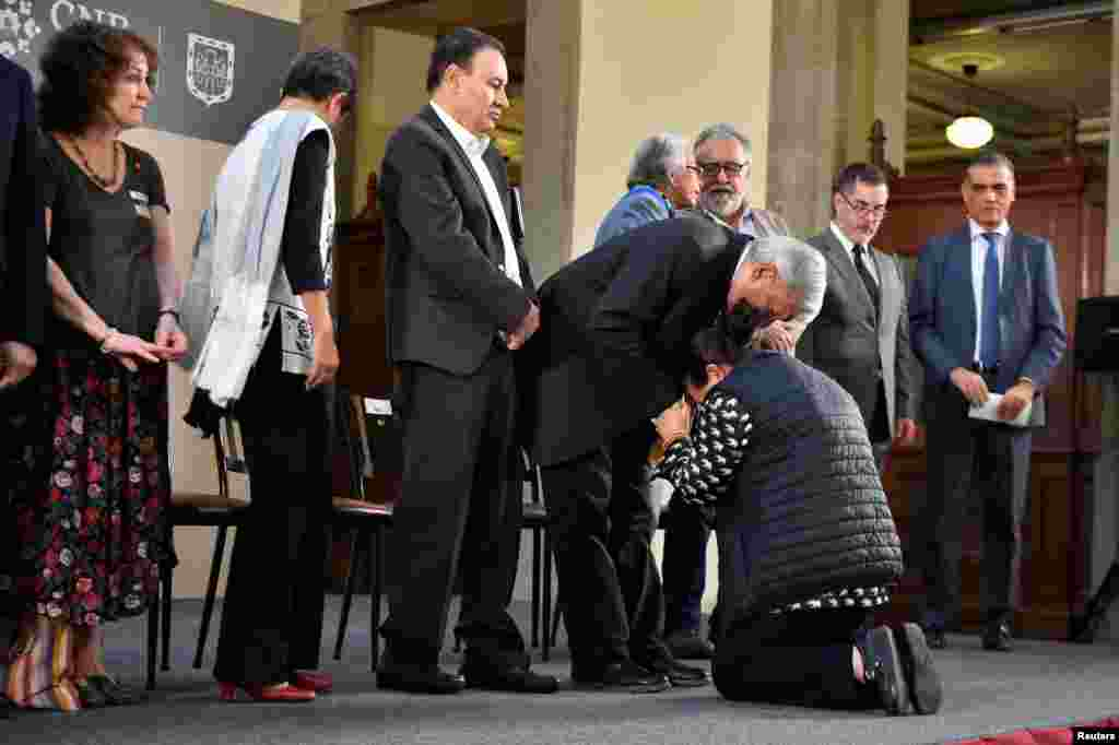 Mexico's President Andres Manuel Lopez Obrador comforts a woman to ask him for help to look for her missing relative at National Palace in Mexico City. Mexican government identified thousands of human remains that have accumulated in morgues and mass graves during more than a decade of gang violence.