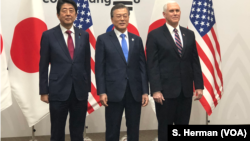 Prime Minister Shinzo Abe of Japan, President Moon Jae-in of South Korea and U.S. Vice President Mike Pence meet in Pyeongchange, South Korea, site of the 2018 Winter Games.