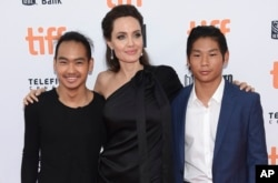 "Maddox Jolie-Pitt, from left, Angelina Jolie and Pax Jolie-Pitt attend a premiere for ""First They Killed My Father"" at the Toronto International Film Festival at the Princess of Wales Theatre, Sept. 11, 2017, in Toronto."