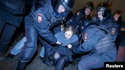 Punk protest band Pussy Riot member Maria Alyokhina is detained by police at a protest in central Moscow February 24, 2014.