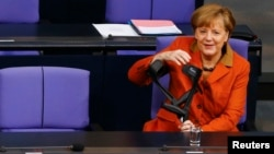 German Chancellor Angela Merkel arrives at the German lower house of parliament Bundestag in Berlin, Jan. 29, 2014.