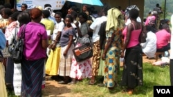 In this 2012 file photo, women wait for family planning counseling outside a health clinic in Uganda. Critics say a government program to send health workers abroad will leave many Ugandans without a healthcare provider. (VOA / Hilary Heuler)