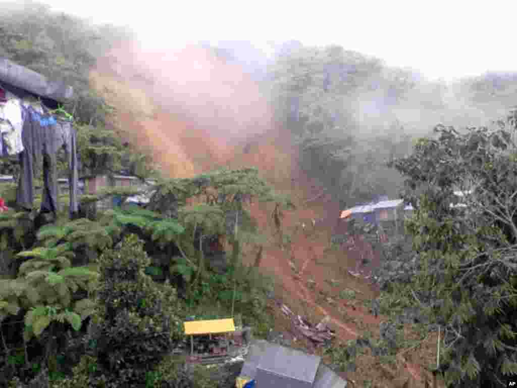 The Bayan Mo Ipatrol Mo (BMPM) provided this photo of the landslide, January 5, 2012. (BMPM/Reuters)