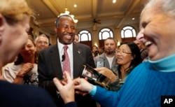FILE - Republican presidential candidate and retired neurosurgeon Ben Carson meets with voters during campaign stop at the University of New Hampshire, Durham, Sept. 30, 2015.