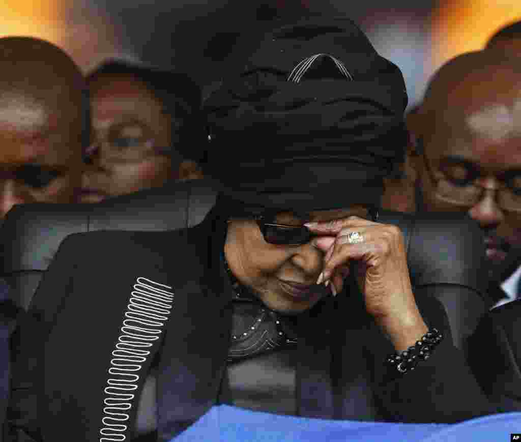 Winnie Madikizela-Mandela, Nelson Mandela's former wife, listens to speeches during his memorial service at the FNB Stadium in Soweto near Johannesburg, Dec. 10, 2013.