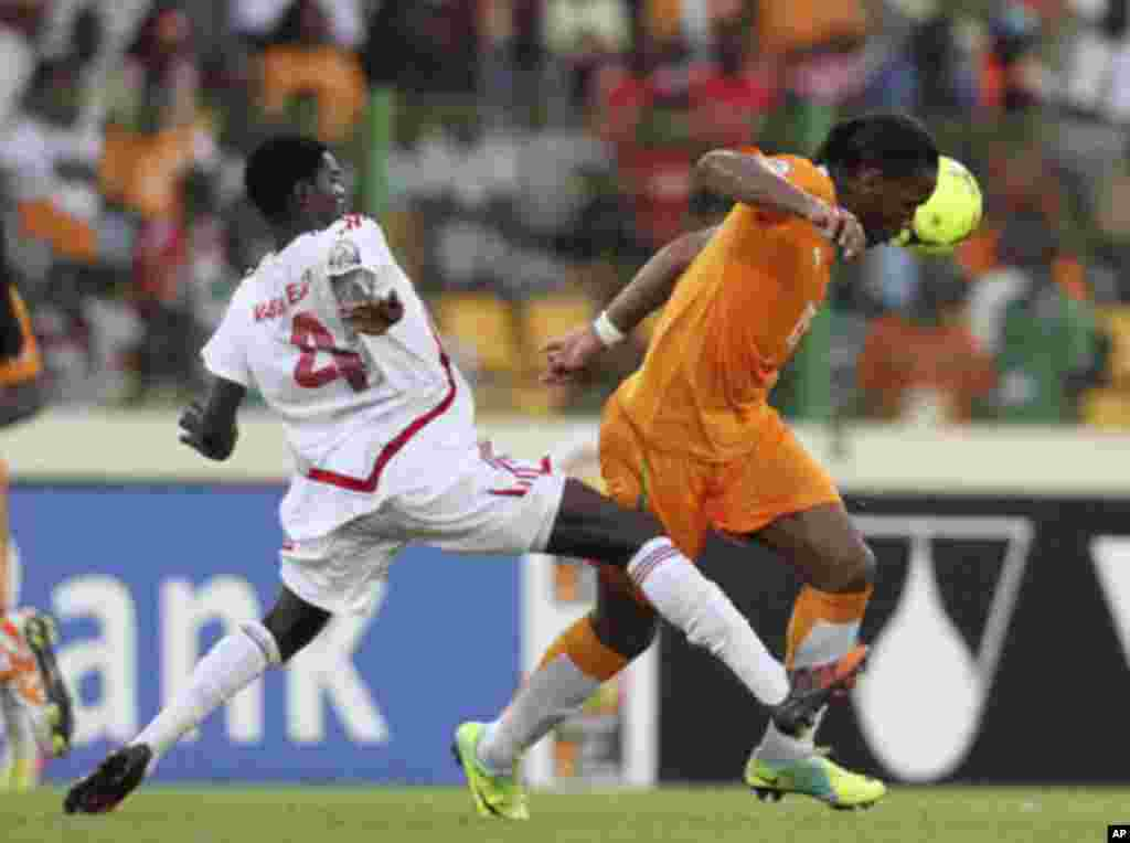 "Ivory Coast's Didier Drogba (R) fights for the ball with Sudan's Abdullah Ngemaldien Najem during their African Nations Cup soccer match at Estadio de Malabo ""Malabo Stadium"", in Malabo January 22, 2012."