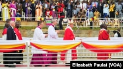 Pope Francis walks across a bridge toward the pulpit to celebrate Mass, in Namugongo, Uganda, Nov. 28, 2015.