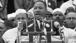 "Dr. Martin Luther King Jr. addresses marchers during his ""I Have a Dream"" speech at the Lincoln Memorial in Washington"