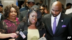 Tiffany Crutcher, center, sister of Terence Crutcher, talks with the media following a verdict in the trial of Tulsa police officer Betty Jo Shelby in Tulsa, Okla., May 17, 2017.