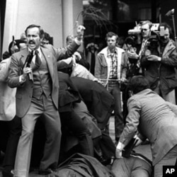 Would-be assassin John Hinckley is wrestled to the ground after he fired his weapon at President Ronald Reagan near a Washington hotel, D.C., March 30, 1981.